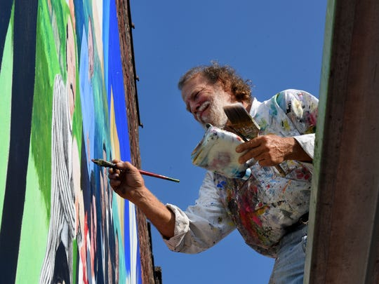 Walt Fieldsa, the original artist for the Knoxville Music History Mural, is restoring the mural and making it even better with the help of the man who had it painted over Wednesday, Jul. 19, 2017.