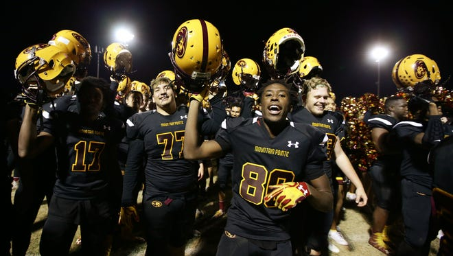 Phoenix Mountain Pointe #80 Christopher Lewis and his teamates celebrate their 21-14 victory over Mesa Red Mountain during the 6A semifinals action played at Tempe McClintock High on Nov. 18, 2016 in Tempe, Ariz.
