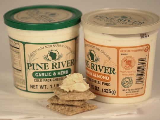 Pine River's garlic & herb cheese spread won a World Championship Cheese Contest gold medal; its swiss & almond spread won a blue ribbon at the Wisconsin State Fair.