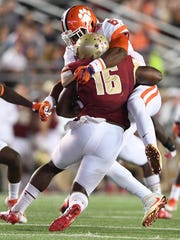 Clemson linebacker Dorian O'Daniel (6) wraps up Boston College running back Davon Jones (16) during the 2nd quarter at Boston College's Alumni Stadium in Chestnut Hill, MA on Friday, October 7, 2016.