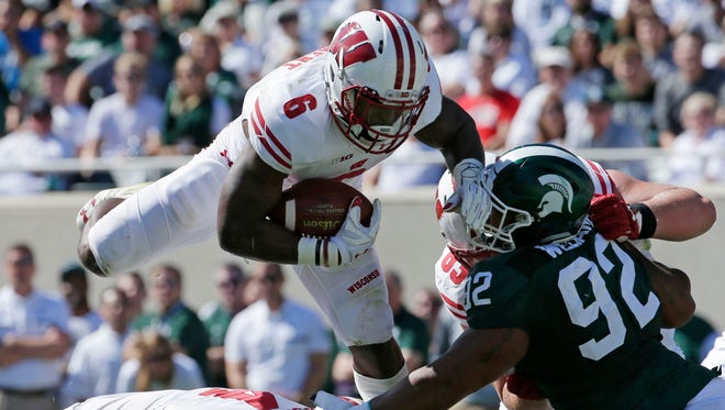 UW running back Corey Clement scored twice against Michigan State despite playing through an ankle injury.