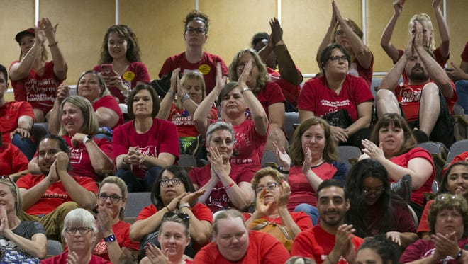 Teachers and other supporters applaud from the gallery while the Senate takes the floor during the sixth day of the Arizona teacher walkout at the Arizona state capitol in Phoenix on Thursday, May 3, 2018.  Today will likely bill the final day of the walkout as Governor Ducey signed an education funding bill into law early Thursday morning.