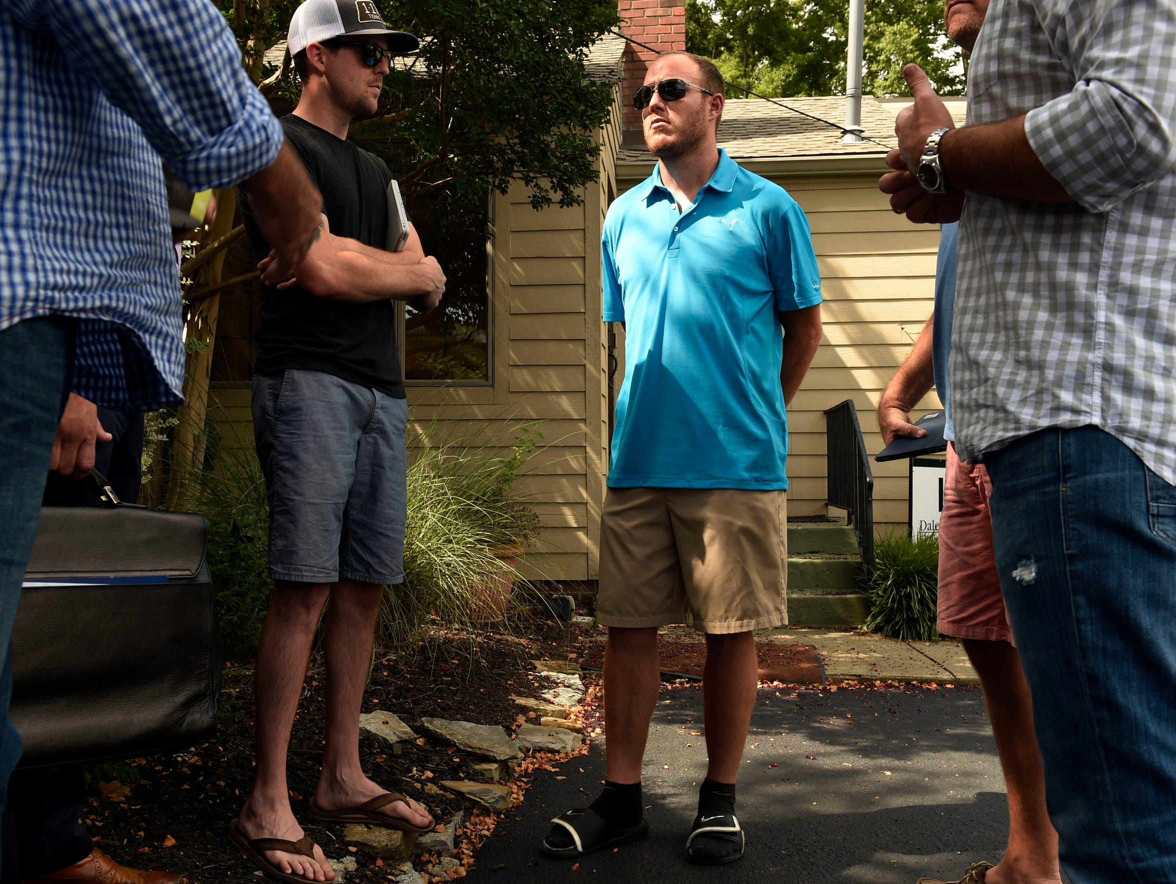 Tim Shaw chats with his business partners on July 21.