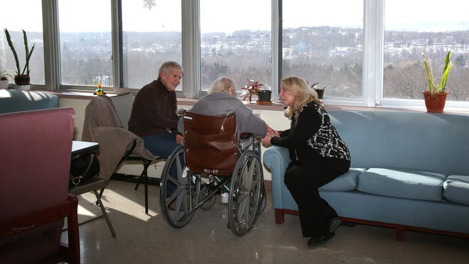 Alice Cooney, left, sits with her mother-in-law, nursing home resident Mary Cooney and social worker Deirdre Fitzpatrick at the Summit Park nursing home in Pomona Feb. 24, 2015. It's one of the few homes in our area that has retained its 4-star rating.