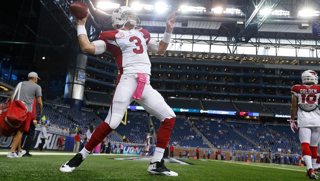 Cardinals quarterback Carson Palmer (3) throws during pre-game warmups of an NFL football game against the Detroit Lions, Sunday, Oct. 11, 2015, in Detroit. (AP Photo/Paul Sancya)