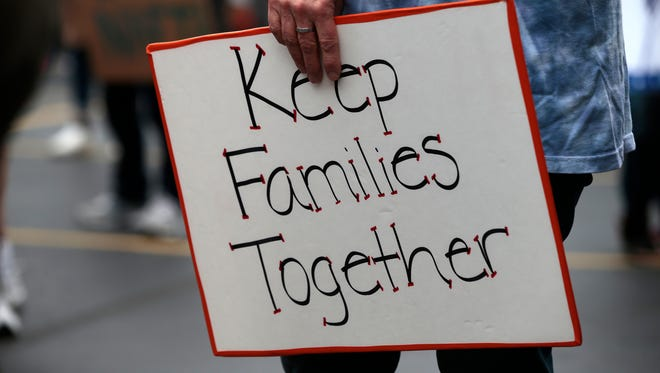 Various faith-based and immigration advocacy groups organized a rally and march against federal policies deporting people who have arrived from Central America in the last two years, Saturday, March 12, 2016, at the Holy Family Church in Price Hill.