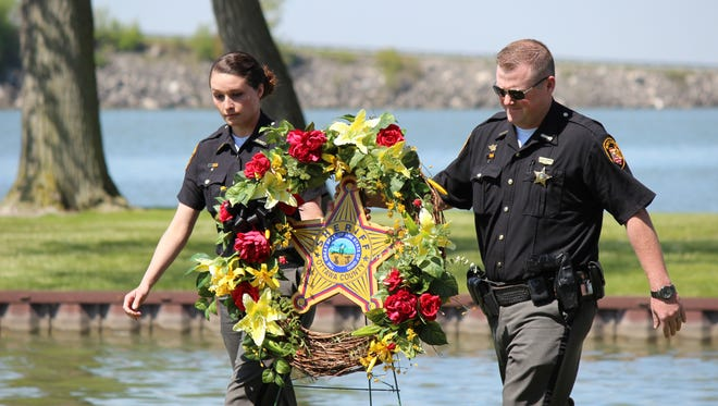 Officers from the Clay Township Police Department remember fallen Patrolman William Hetrick at the the 2016 Ottawa County Peace Officers Memorial service hosted by the Marblehead Police Department at Bay Point on Thursday.