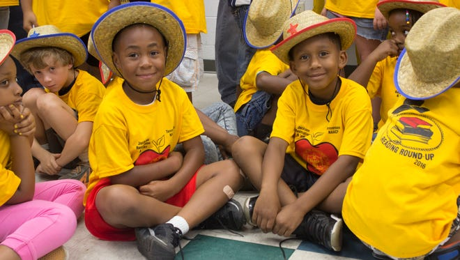Six-year-old Darris Croom, left, learned better reading skills during the Reading Roundup program.