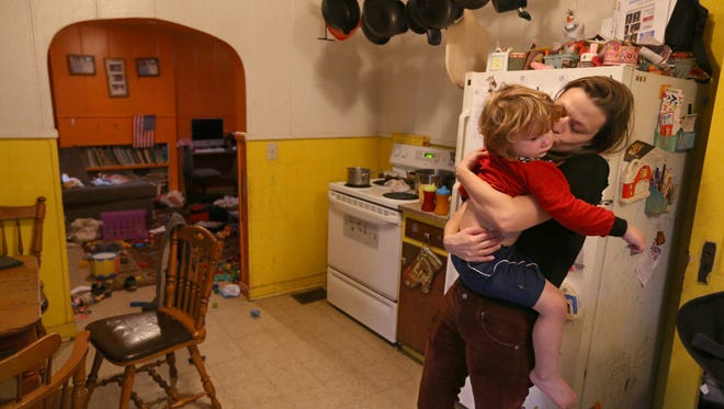 Kara Helstrom comforts her son Jonah, 3, in the kitchen at their home on Jackson Street in Geneva Friday, Oct. 21, 2016.   Tests have found elevated lead in Jonah's blood.