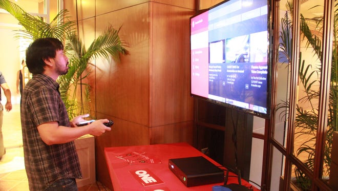 Bobby Bonifacio, creative manager with Docomo Pacific, experiments with the new TiVo platform at the ONE bundle launch event Thursday, April 20 at the Guam Hilton Resort and Spa.