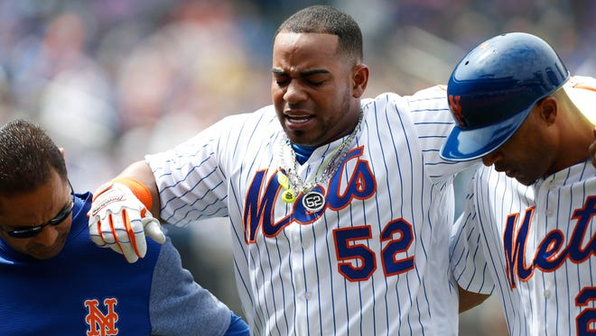 Yoenis Cespedes of the Mets reacts after injuring his hamstring in the fourth inning against the Braves at Citi Field.