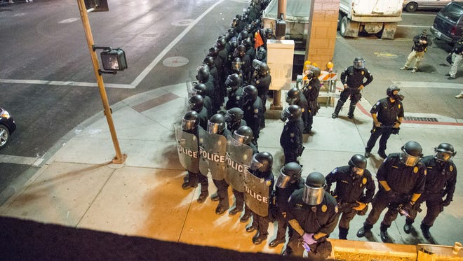 Phoenix police fired gas, foam projectiles and pepper balls on protesters after President Donald Trump's rally in Phoenix on Aug. 22, 2017.