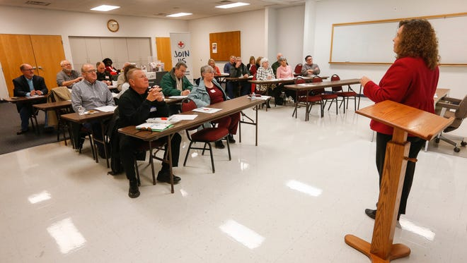 Stacy Burks, executive director of the American Red Cross, talks to a group of retirees and senior citizens on Wednesday, Jan. 17, 2018 as part of a new City of Springfield program called Give 5 that helps them get involved in volunteer work.
