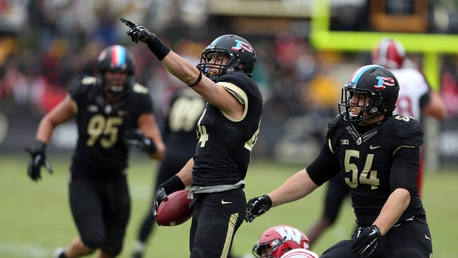 Purdue Boilermakers safety Landon Feichter (44) reacts to making an interception against Wisconsin at Ross Ade Stadium.