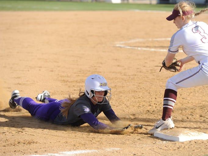 Hardin-Simmons shortstop Kirsten Kenyon slides into