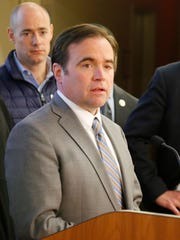 Cincinnati Mayor John Cranley speaks about possible upcoming changes to the city's 911 services and the working conditions of those in the call center at the Hamilton County Emergency Communications Center in East Price Hill on Monday, April 23, 2018.