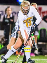 Pocomoke attack Lexi Butler (12) battles up field against