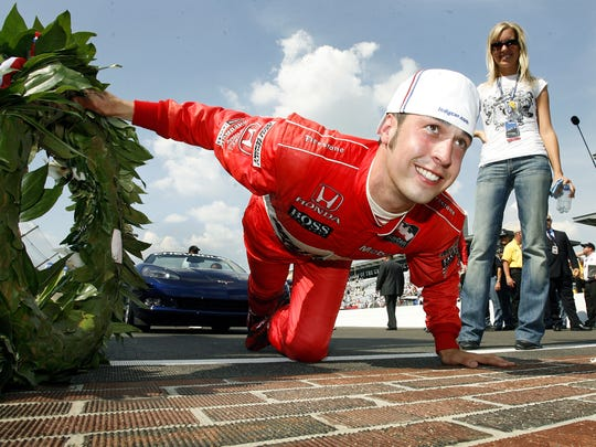 Hornish prepares to kiss the bricks after winning. His wife Crystal stands at back. Sam Hornish Jr. won the 90th running of the Indianapolis 500 was held Sunday afternoon, May 28, 2006 at the Indianapolis Motor Speedway. (Sam Riche / The Indianapolis Star)