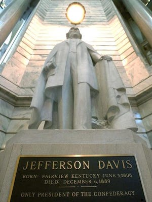 A statue of Confederate President Jefferson Davis stands in the Capitol Rotunda in Frankfort, Ky.
