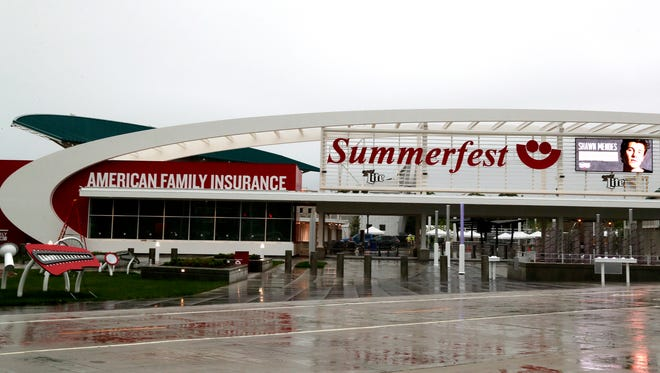 The newly built north entrance to Summerfest has features similar to the new Milwaukee Bucks area with curved lines like a wave.
