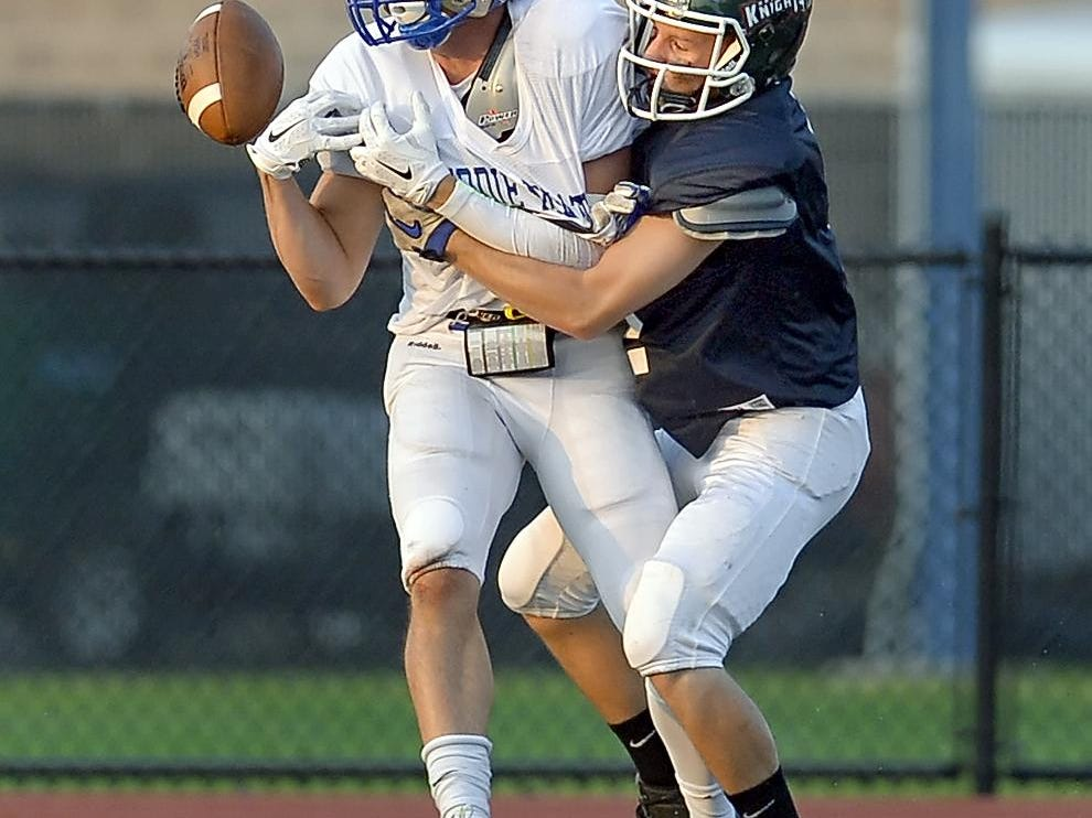Webster Schroeder's Will Blake, left, reaches for a pass while defended by Avon's Joey Sotak during the 33rd Annual Eddie Meath All-Star Game played at Eastridge High School on Saturday, July 11, 2015.