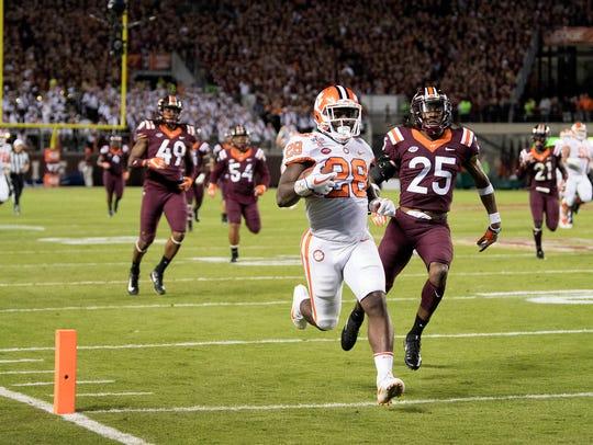 Clemson running back Tavien Feaster (28) scores a touchdown