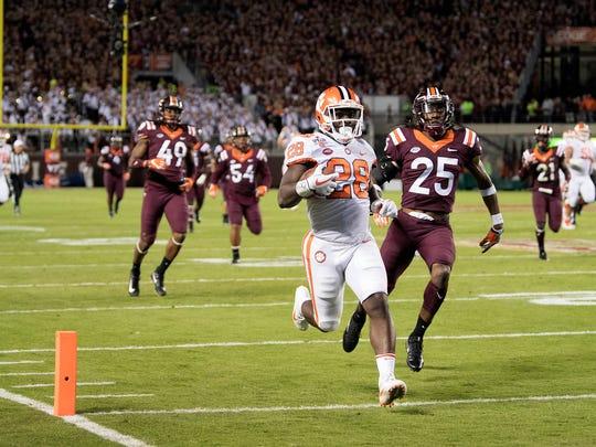 Clemson running back Tavien Feaster (28) scores a touchdown during the first quarter against Virginia Tech at Lane Stadium.