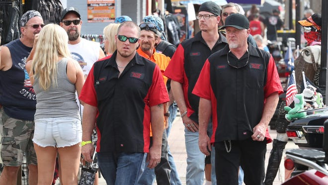 Sidewalks were crowded last March during Bike Week, which was underway just as the first local COVID-19 cases were reported.
