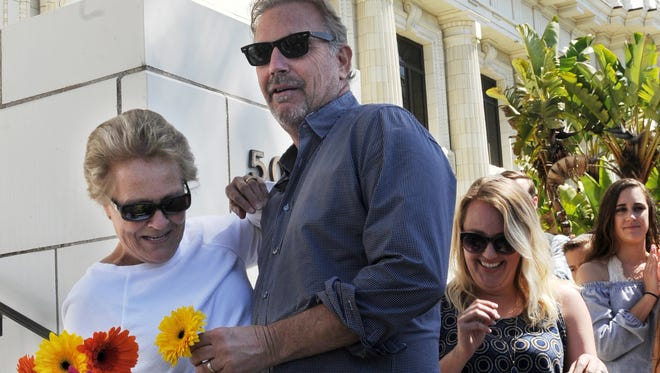 Kevin Costner makes a surprise visit Saturday to congratulate Kathy Vaughan on the front steps of City Hall in Ventura for being such a good mom. Vaughan's daughter Aimee Foster, right, sports a big smile.