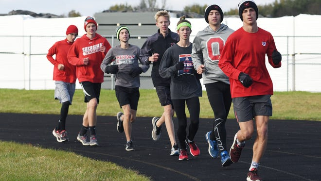The Sheridan High School cross country team is heading to the state meet again. Luke Brown, right, Kyle Clellan, Brandon Lanning, Max Smith, Mitchell Wells, Ethan Malone and William Wilke practiced on Tuesday in preparation for this weekend.