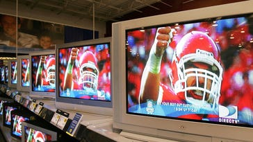 NILES, IL - JANUARY 31: Flat-panel wide screen televisions display a football player a Best Buy store January 31, 2006 in Niles, Illinois. Sales of televisions are reportedly up after the Holiday season as the NFL's Super Bowl approaches. (Photo by Tim Boyle/Getty Images)
