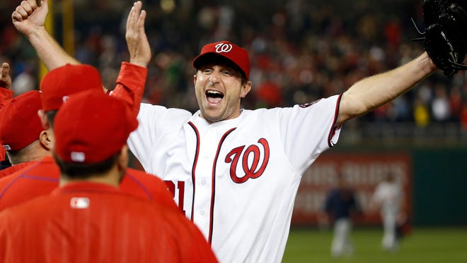 Nationals pitcher Max Scherzer celebrates with his teammates after the Tigers' 3-2 loss Wednesday in Washington.