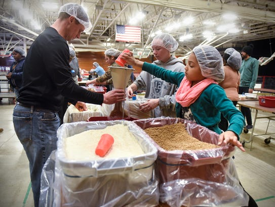 Volunteers prepare meals as part of Day of Service
