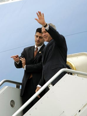 President Bush waves as he steps off Air Force One