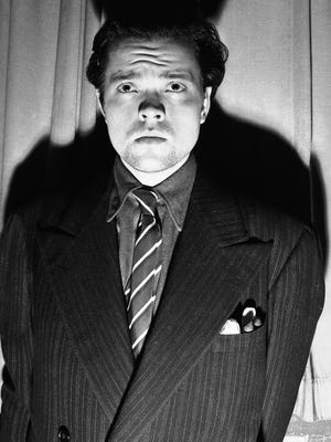 "Orson Welles, radio and stage actor, whose dramatization, Oct. 30, 1938 of an H. G. Wells novel titled ""War of the Worlds"" which related the ""invasion"" of New Jersey by a horde of men from mars was interpreted by listeners as an actual news broadcast."