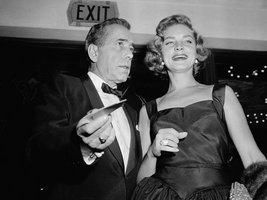 """Humphrey Bogart and wife Lauren Bacall at the premiere of  """"The Desperate Hours"""" in Los Angeles on Oct. 12, 1955."""