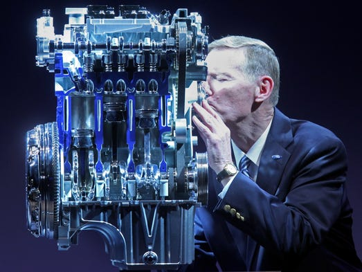 Alan Mulally, Ford CEO kisses the UK-designed Ford 1.0 EcoBoost engine