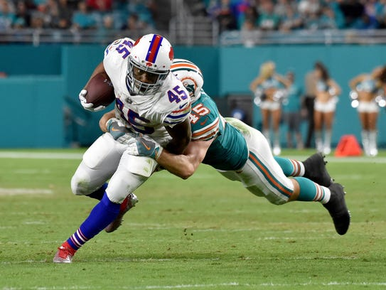 Buffalo Bills running back Marcus Murphy (45) is tackled