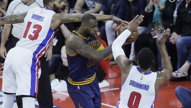 Detroit Pistons center Andre Drummond (0) and forward Marcus Morris (13) defend against Cleveland Cavaliers forward LeBron James during the first half in Game 3.