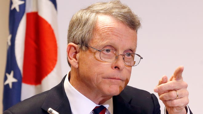 Ohio Attorney General Mike DeWine takes a  question at a news conference where he announced indictments against four additional people in relation to the 2012 rape of a high school student on Nov. 25, 2013, in Steubenville, Ohio.