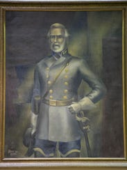 A portrait of Gen. Robert E. Lee hangs over the Lee