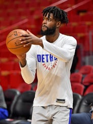Pistons wing Reggie Bullock warms up prior to the game