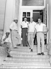 Roy Bryant, right, and his half-brother, J.W. Milam, second from right, walk Sept. 30, 1955, down the steps of the Leflore County Courthouse in Greenwood, Miss.
