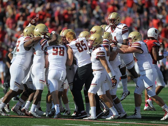 Boston College celebrates after beating Louisville