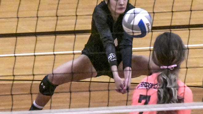 Garden City High School's Abby Parr digs a shot in a match against Dodge City earlier this season at GCHS. The Buffaloes won the WAC tournament Saturday, for the 10th consecutive year.