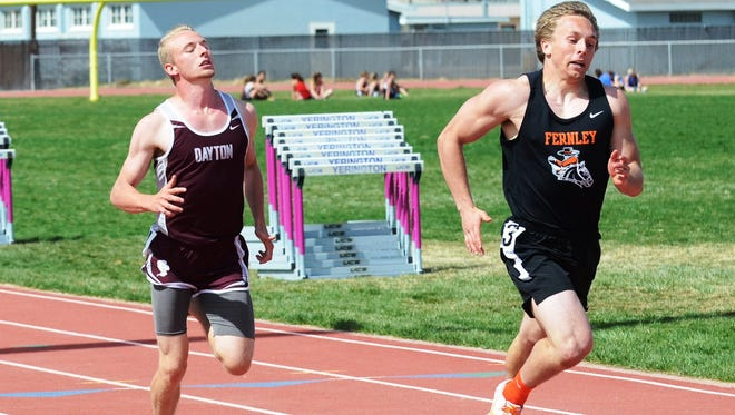 Dayton Tobias Tapley and Fernley's Devin Archer race to the finish of the 100 meter dash in a meet earlier this season.