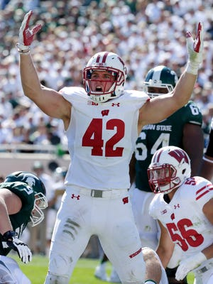 Wisconsin linebacker T.J. Watt (42) reacts after a teammate sacked Michigan State quarterback Tyler O'Connor (not pictured) during the fourth quarter of their game at Spartan Stadium on Saturday.