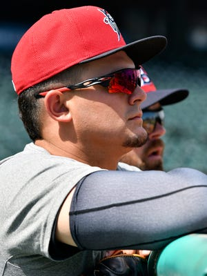 Louisville Bats pitcher Sal Romano looks on as his teammates take fielding practice during the Bats Media Day at Louisville Slugger Field, Wednesday, April 5, 2017 in Louisville.