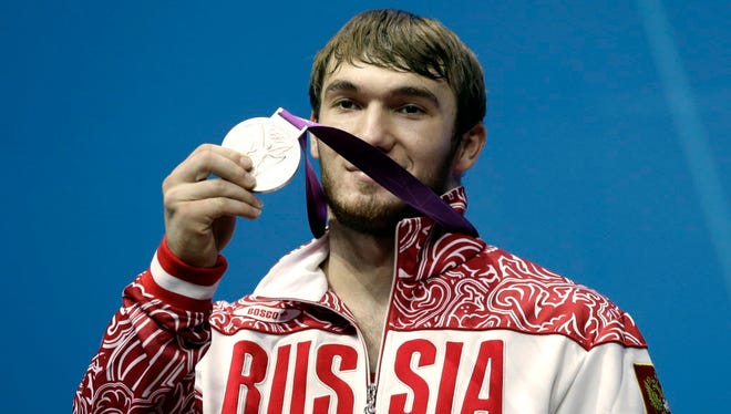 Apti Aukhadov has been stripped of his silver medal from the 2012 London Olympics after testing positive for steroids in a reanalysis of his doping samples.