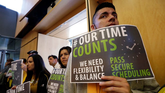 Joe Solorio and other backers of new scheduling rules for hourly workers, Seattle, Sept. 19, 2016.